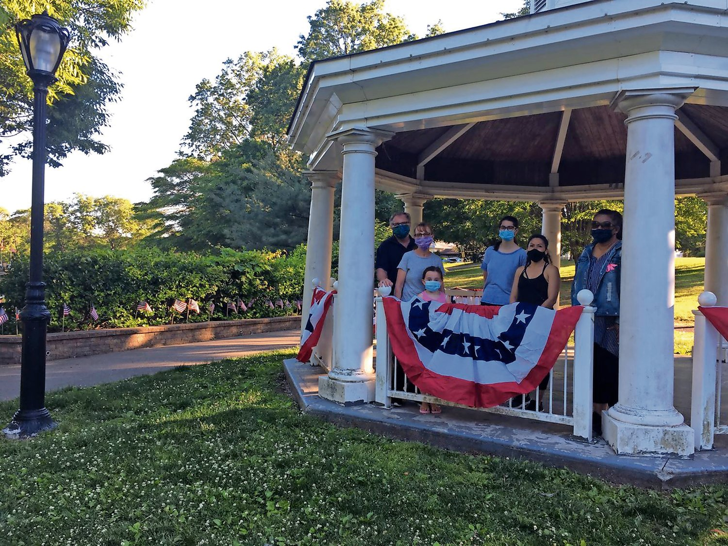 The West Hempstead Community Support Association gathered at Hall's Pond Park to place flags at the park last month.