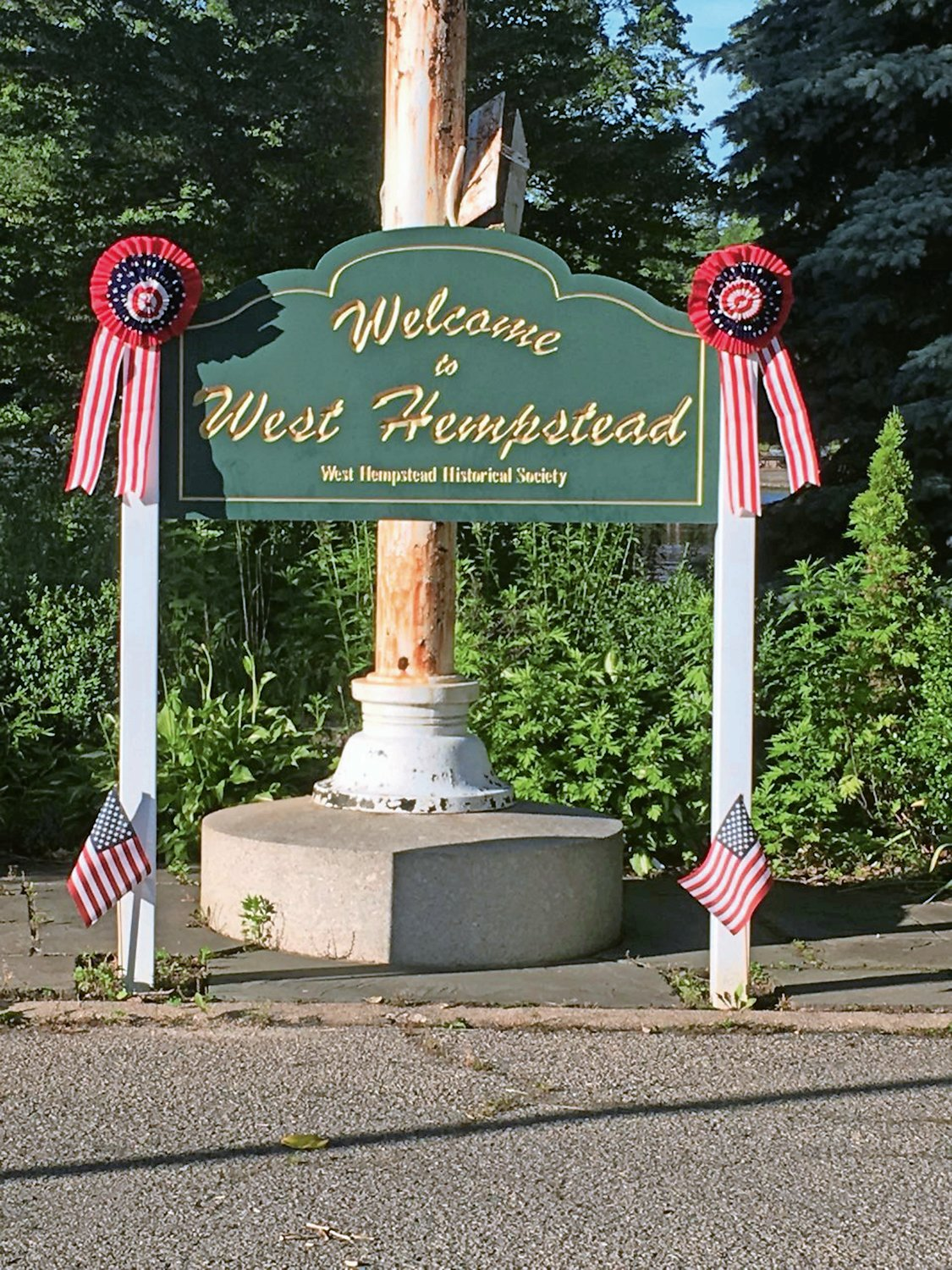 The group also placed flags at the greeting sign.