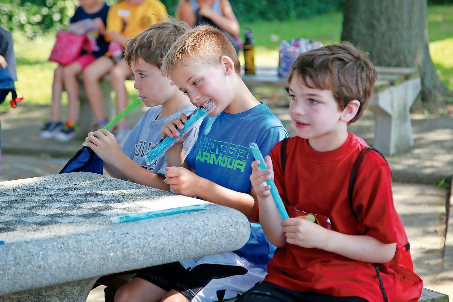 Last year, 7-year-olds James Muldoon, Kevin Benson and Drew Cowley cooled off with some ices at the Summer Playground program. This year, campers will maintain six feet apart, among following other safety precautions, but there will still be ice pops for the kids.