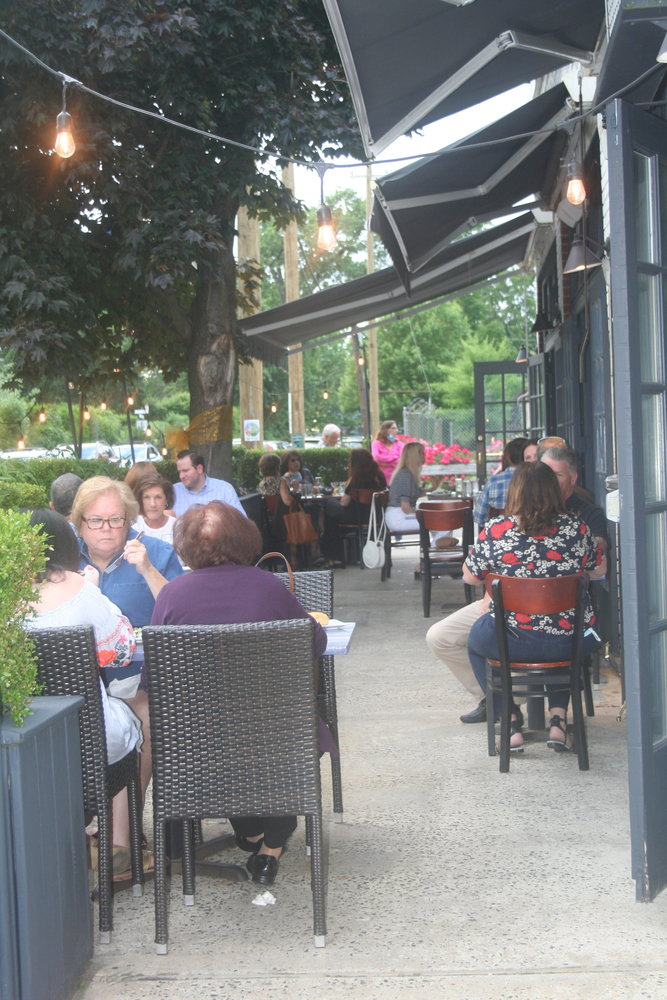 The Metropolitan Bistro has two outdoor dining areas, both of which follow social distancing guidelines.