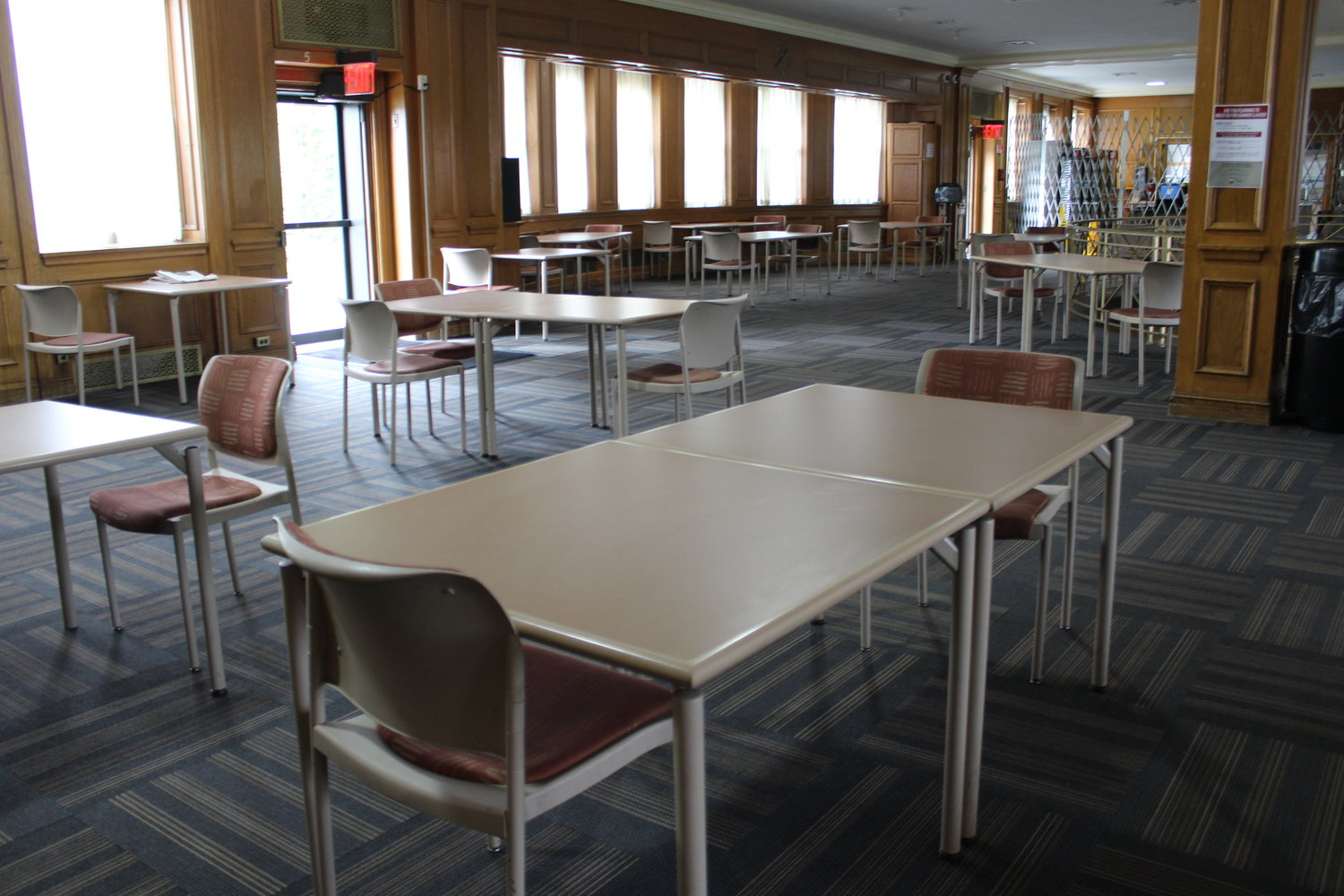Tables in the college's cafeteria will have fewer chairs to maintain social distancing.