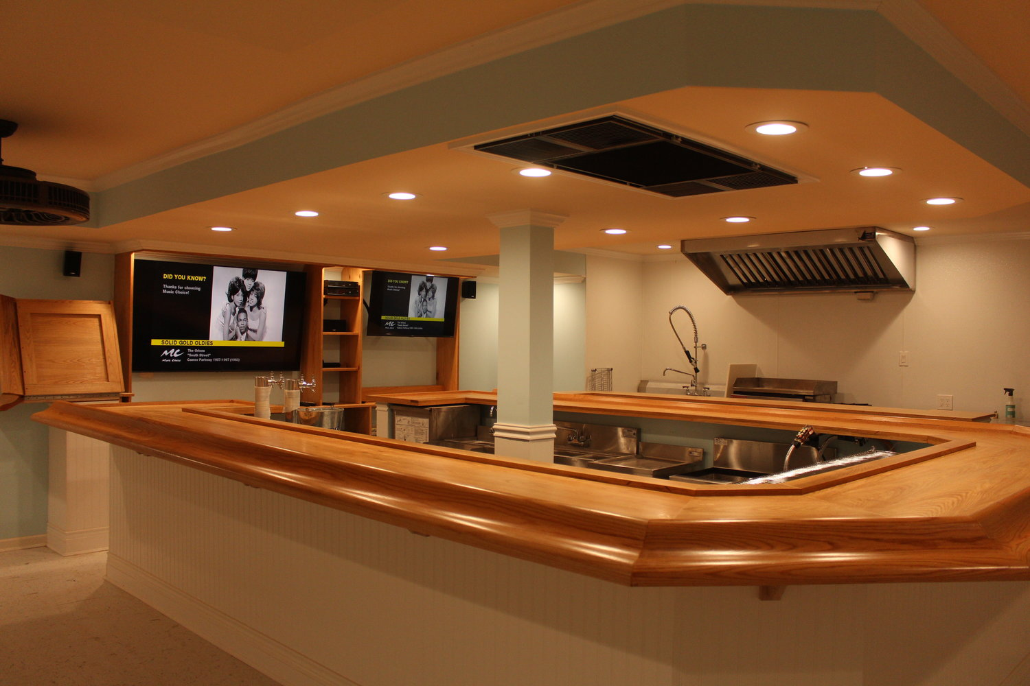 The newly renovated lounge, which is not yet finished, features a horseshoe oak bar.