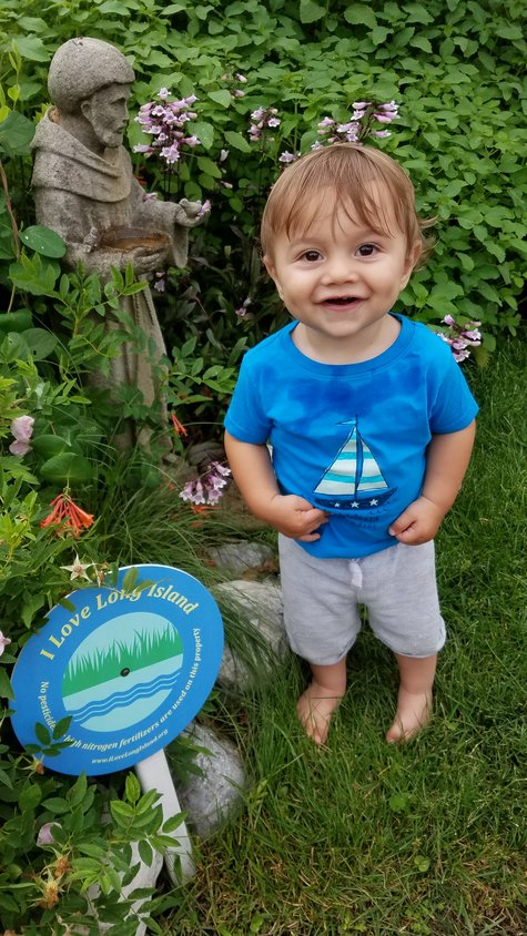Marinello's 2-year-old nephew, Enzo Marinello, is one of many children in the community who rummages through his garden for berries.