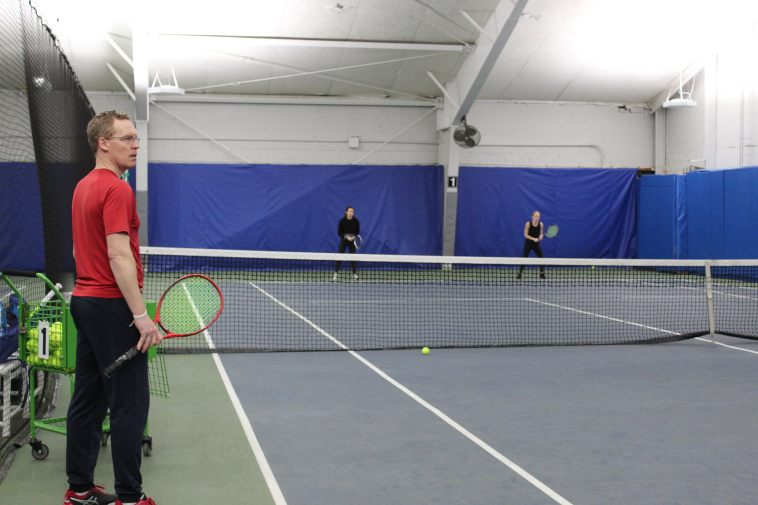 Instructors like Jason Strong can teach clients at Glen Head Racquet Club as they remain socially distant.