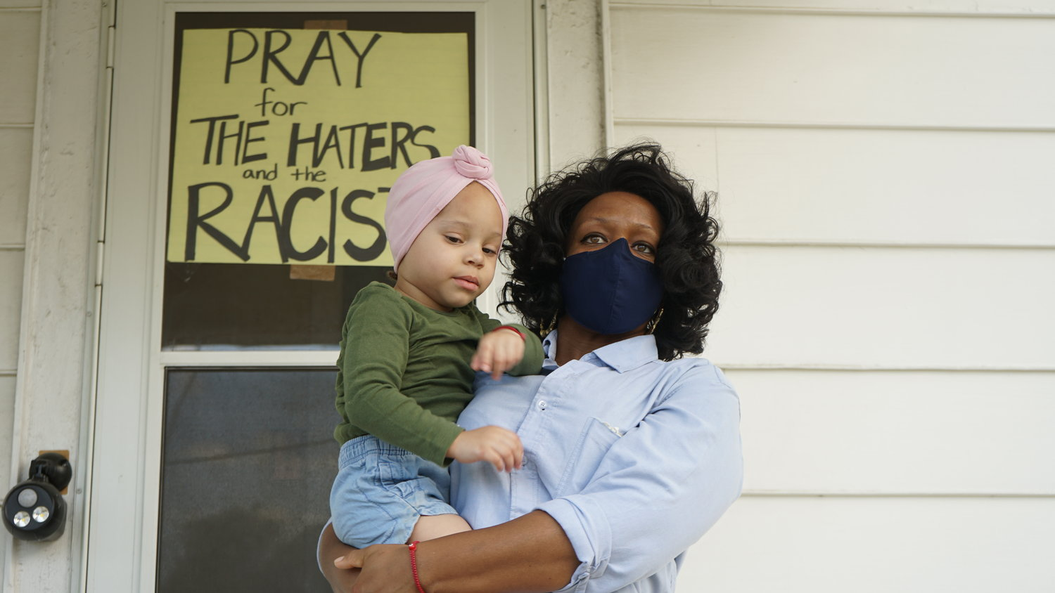 Valley Streamer Jennifer McLeggan with her daughter Immaculate. For the past three years she said she has suffered racially motivated harassment from a trio of neighbors.