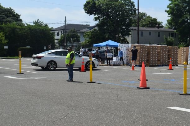 Motorists were directed to one of four lanes for produce pick up at the Gural JCC's free food distribution on July 15.