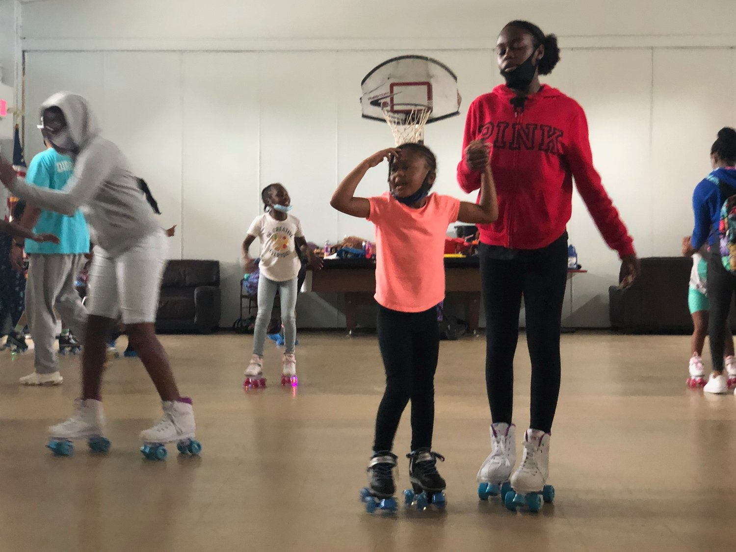 Shyanna Morris, 14, right, roller skated at the MLK Center with Leah Long.