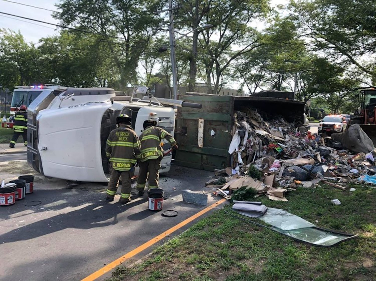 On Sunday, the Merrick Fire Department responded to an overturned sanitation container truck on Merrick Road near the entrance of the Town of Hempstead's waste transfer station in Merrick.