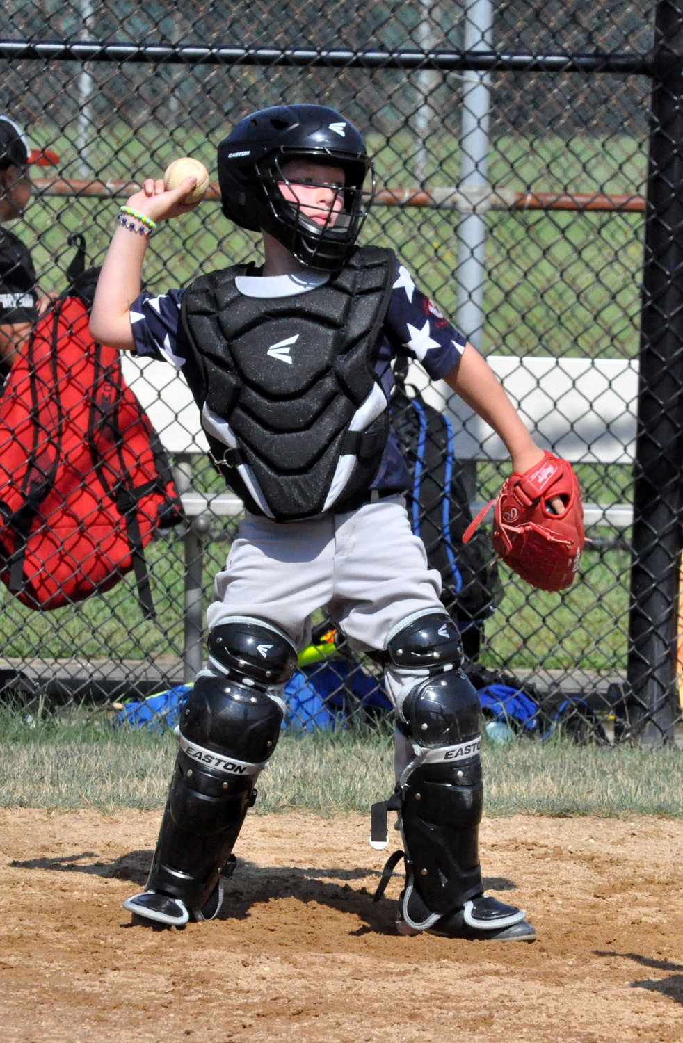 Daniel Pilott braved the heat to work some innings behind the plate.