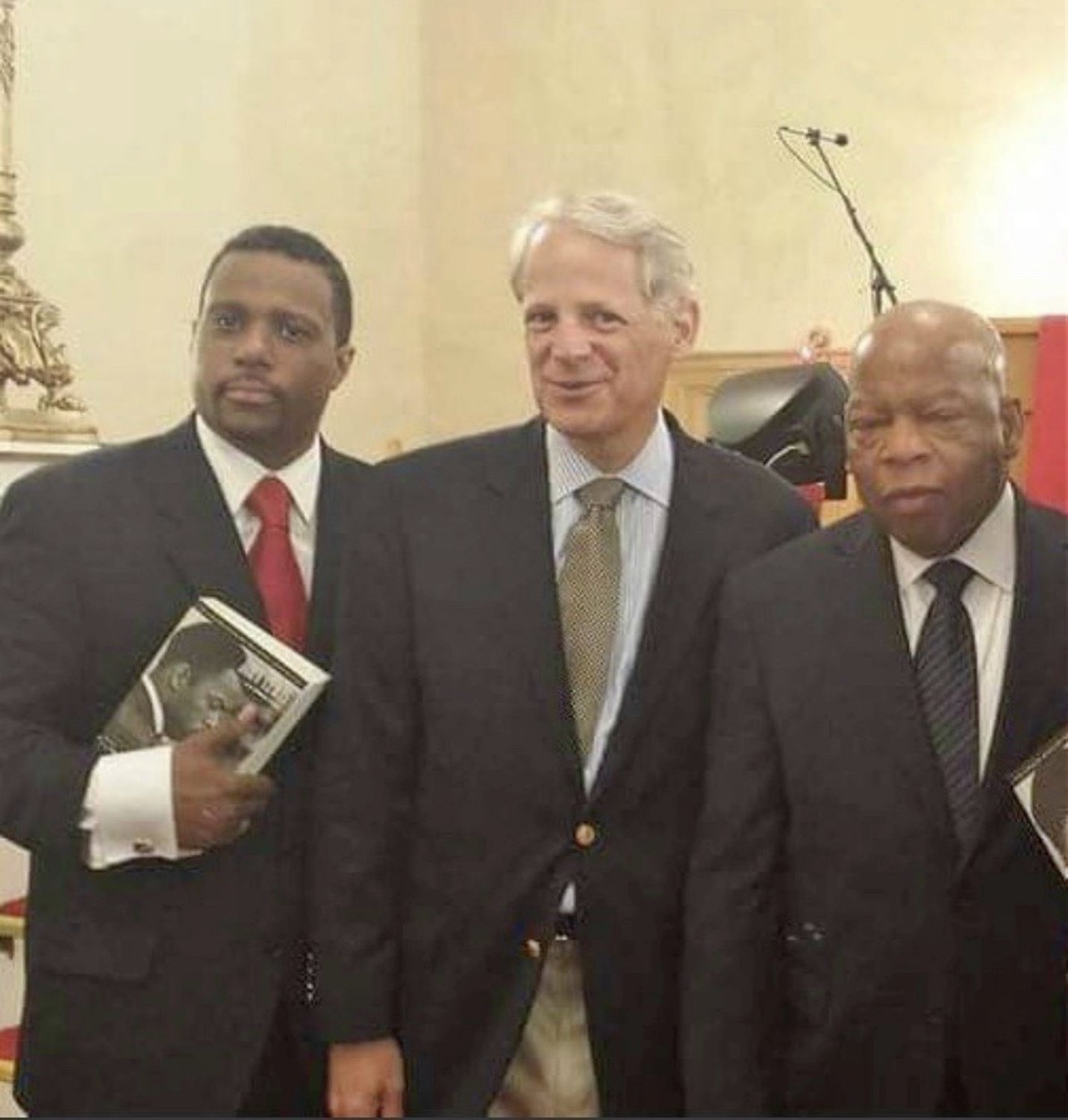 The Rev. Roger Williams, left, former U.S. Rep. Steve Israel and Rep. John Lewis at an event at First Baptist Church of Glen Cove in 2014.