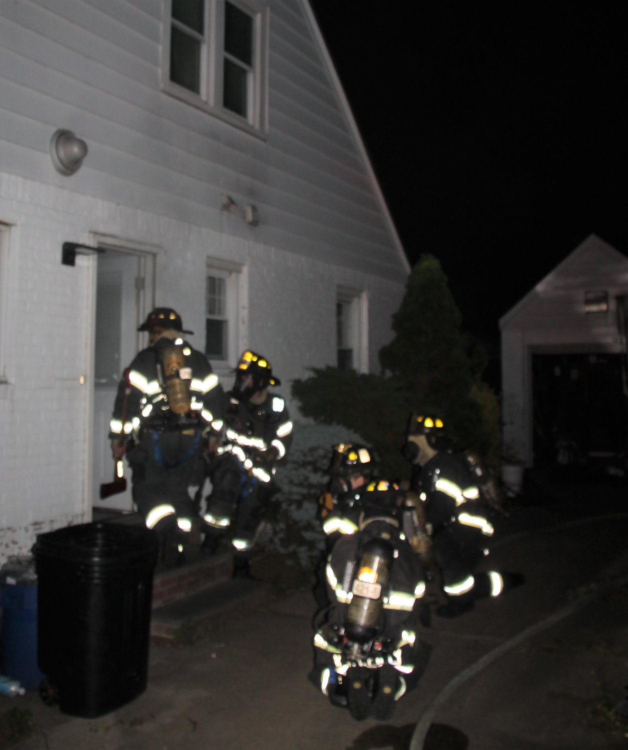 Lynbrook firefighters moved hose lines into a home on Lakeview Avenue to fight a fire in the basement on July 18.