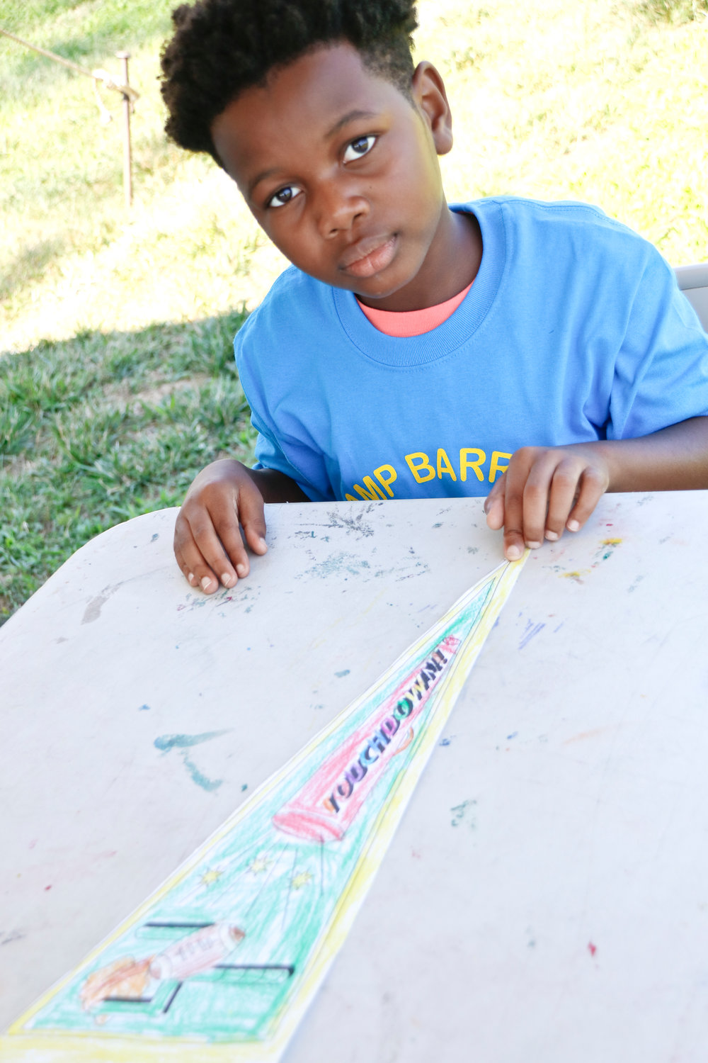 In arts and crafts Marcus Brathwaite colored in a team pride sports pennant.