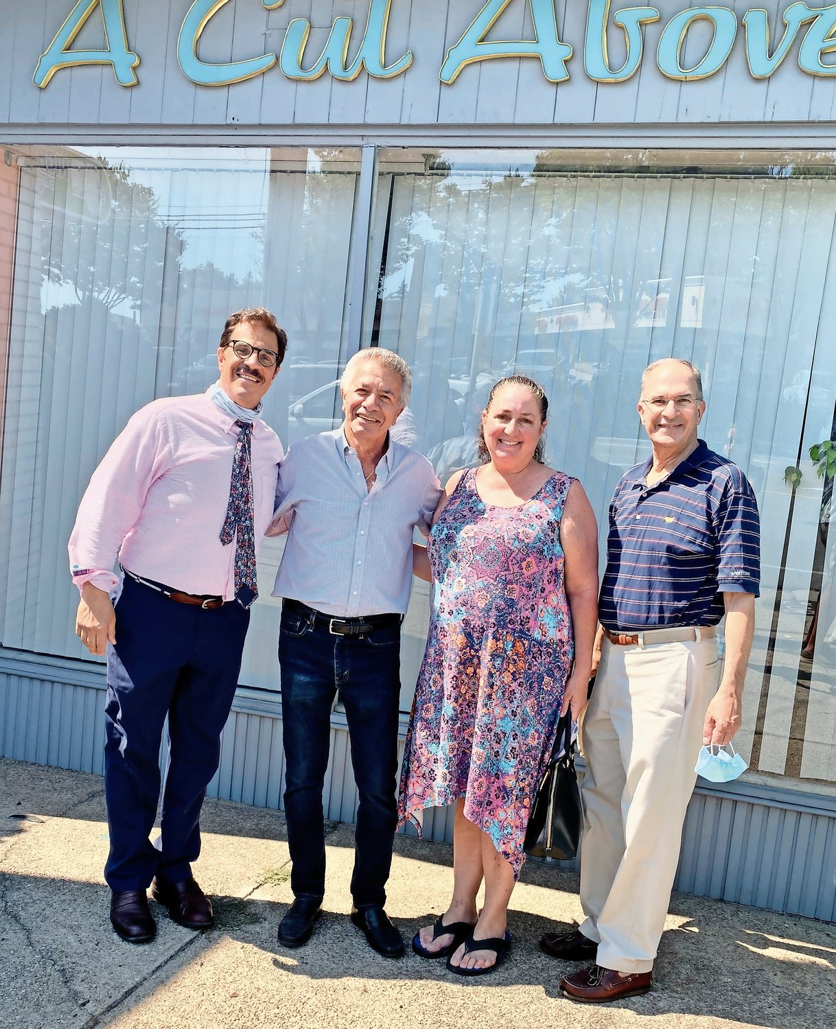 Town Councilman Thomas Muscarella, Franklin Square Chamber of Commerce President Lisa DelliPizzi and Nassau County Legislator Vincent Muscarella congratulated John Gigante, second from left, on his retirement.
