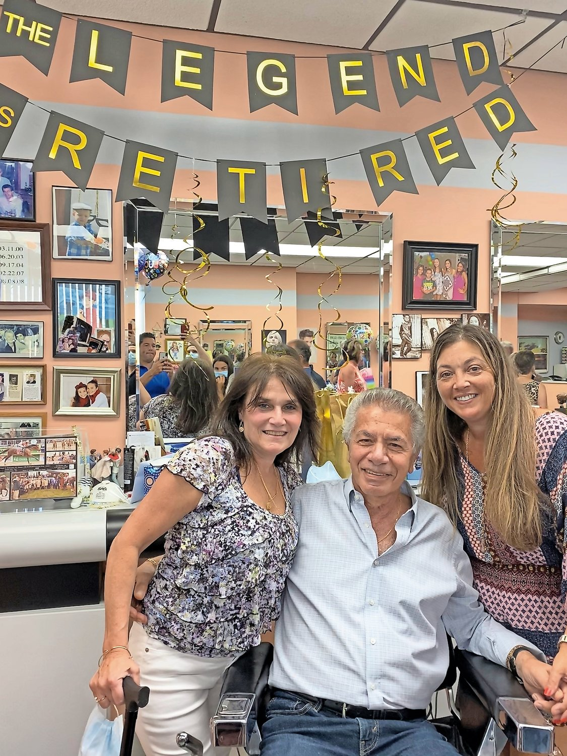 John Gigante retired from A Cut Above, on Hempstead Turnpike in Elmont, after 45 years last Saturday. He celebrated with employees Donna DeGiuli, left, and Kathy Chernow.
