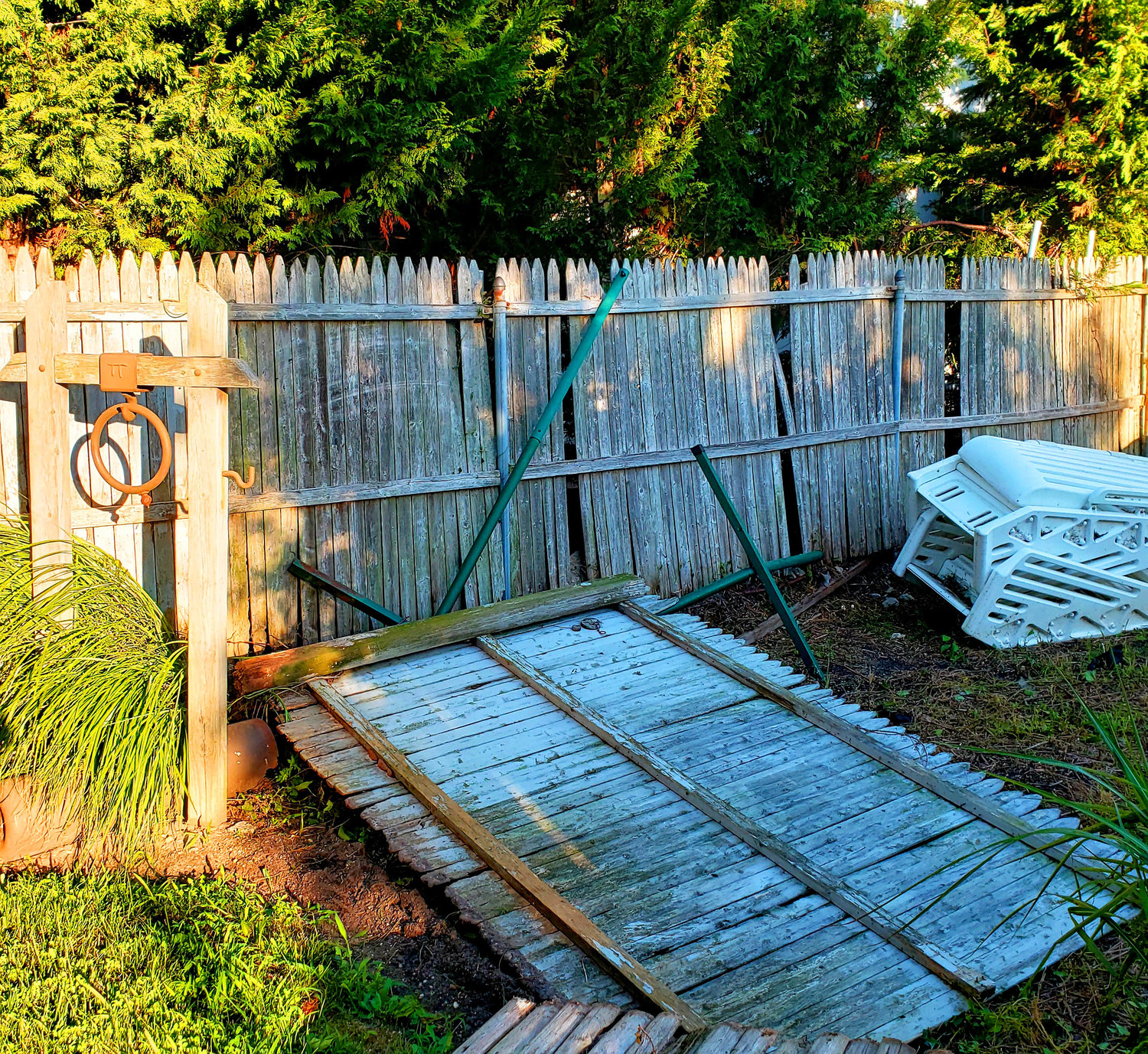 A fence fell from storm damage at Washington Place in Island Park.