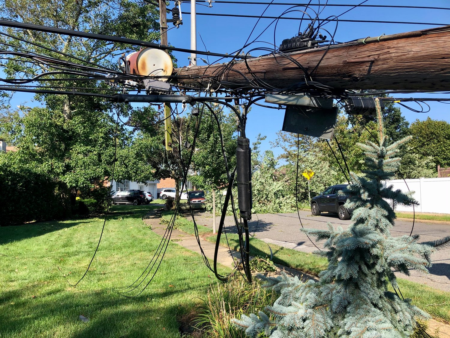 Tropical Storm Isaias brought down hundreds of phone and electric wires across Nassau County, like this one at Shore Drive and Helen Court in Merrick.