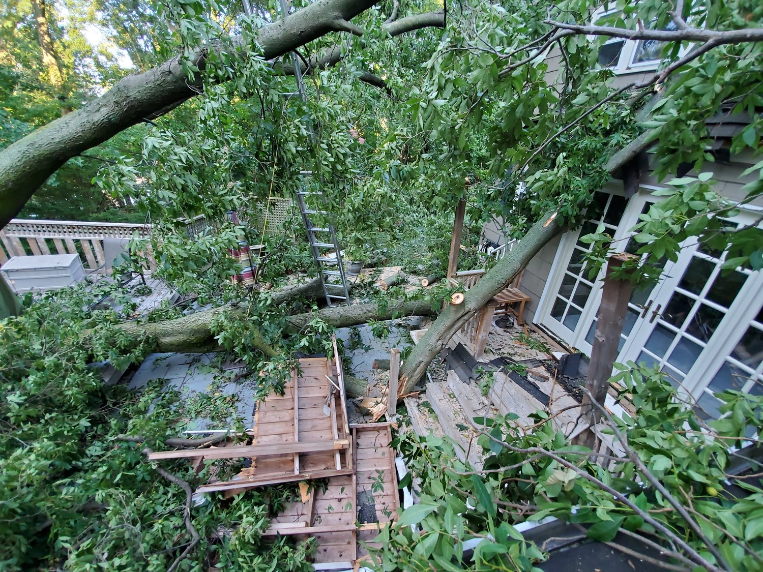The back deck of a house on Woodridge Lane in Sea Cliff was heavily damaged by a fallen tree.