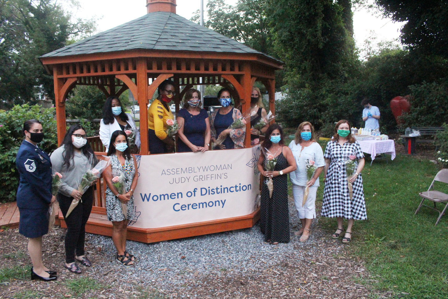 Campbell-Ham was one of 10 women recognized by Griffin, center, at the ceremony, held in the Baldwin Community Garden.