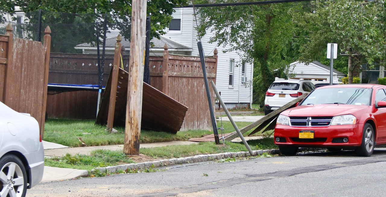 On Field Place in Baldwin, a fence blew apart and onto a car.
