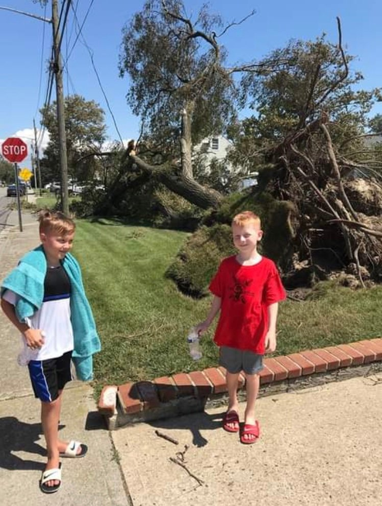 Harbor Isle residents Kieran, left, and Kaiden Callanan assessed the damage.