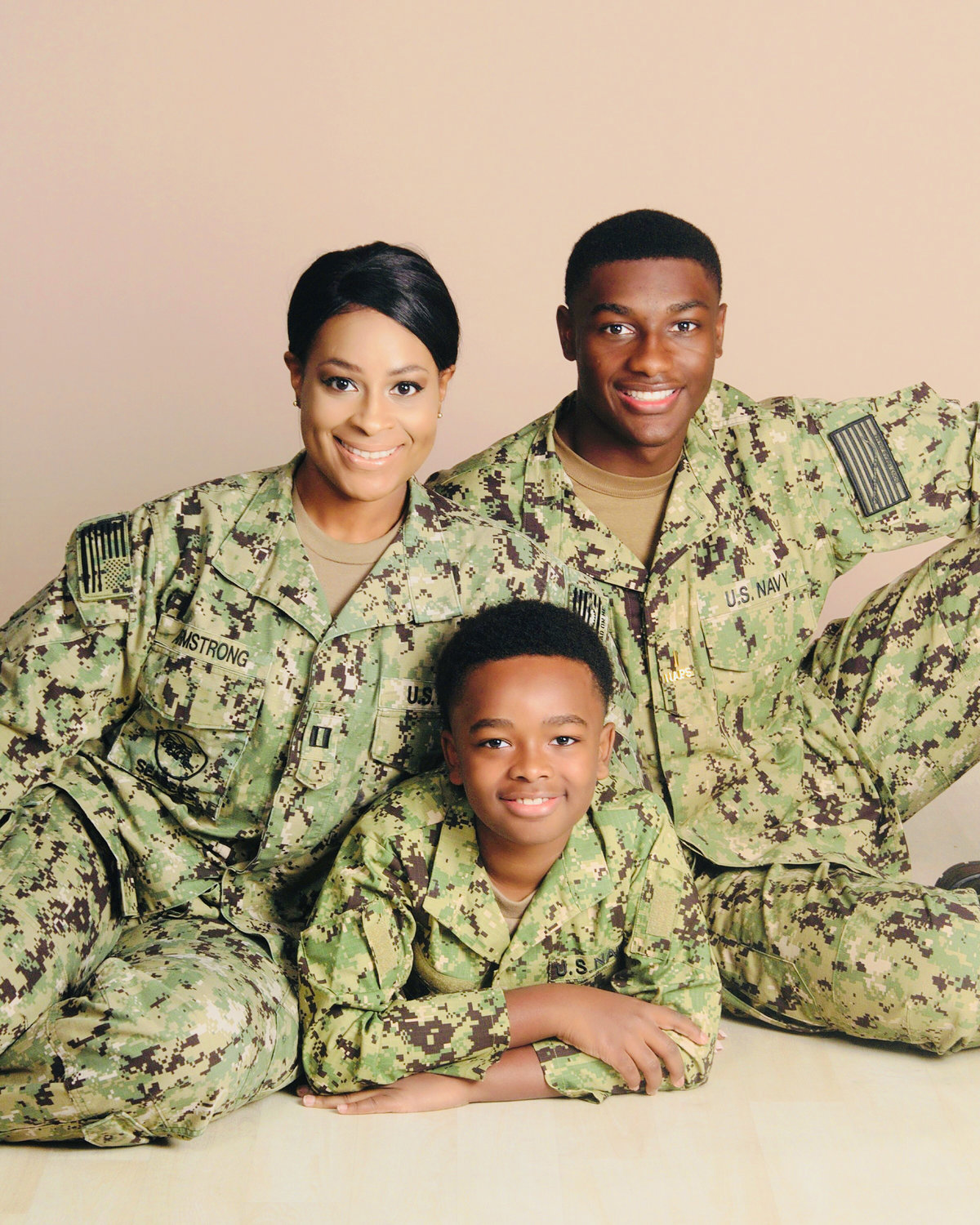 U.S. Naval Academy Lt. Yvonne Armstrong with her sons Christian, center, and Zion.
