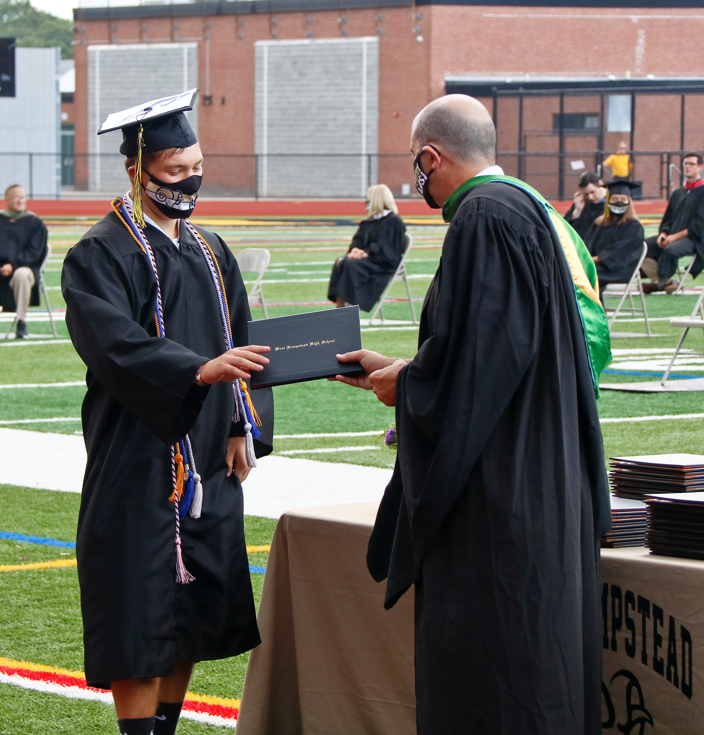 West Hempstead High School National Honor Society member Matthew Friedman, left, was presented with his diploma by Principal James DeTommaso during the school's 66th annual graduation ceremony.
