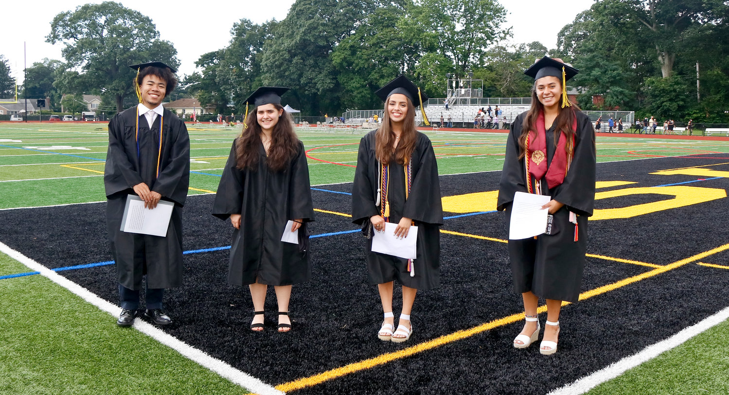 Valedictorian Runako Miot, left, salutatorian Sabrina Manuel and class co-presidents Victoria Tudisco and Kristine Romero spoke at all four of the graduation ceremonies.
