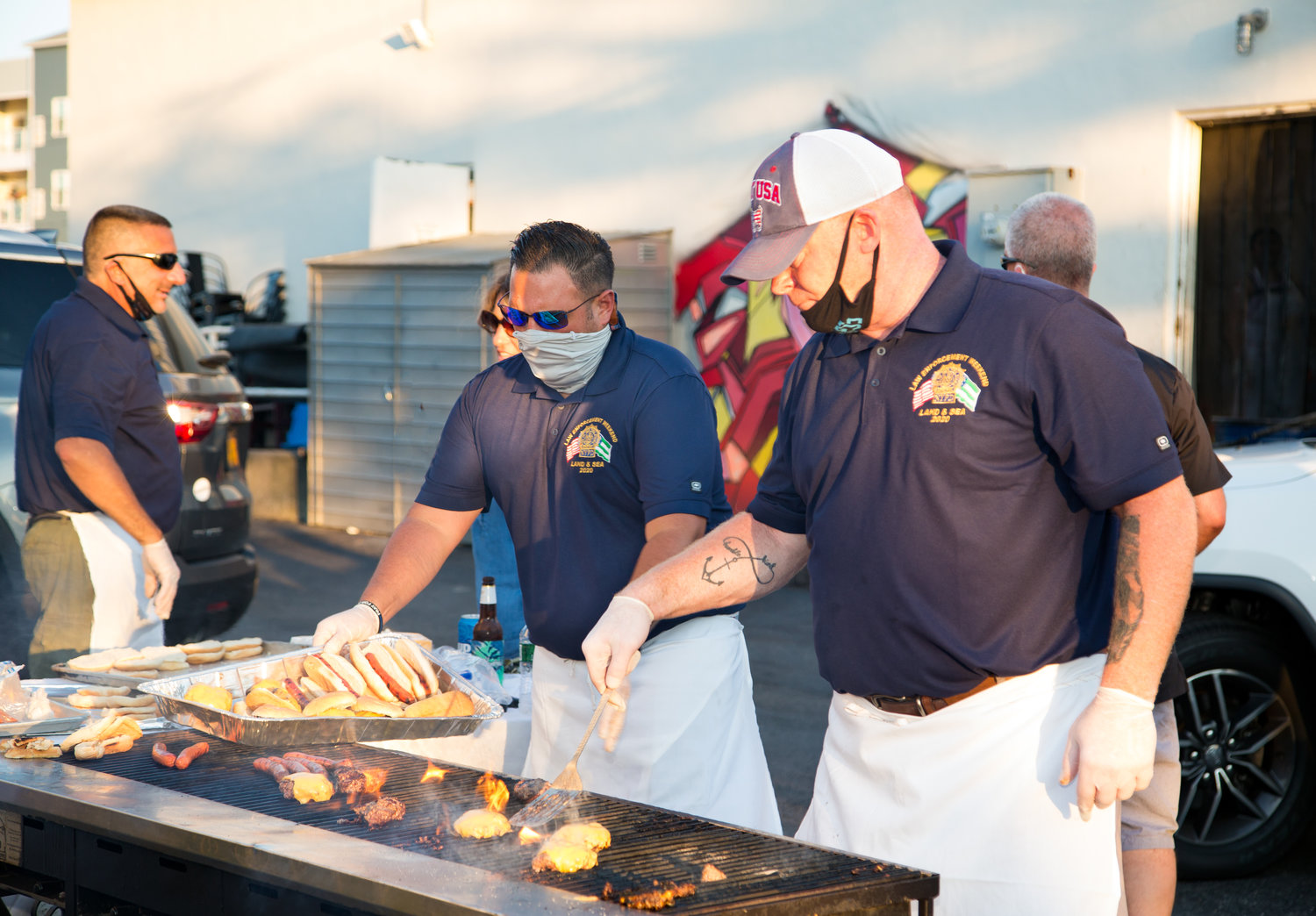 "Hempstead Town Supervisor Anthony D'Esposito, left, and EGP Land & Sea owner Tim O'Hagan grilled food for police officers as part of the ""Back the Blue"" outing in Island Park on July 31."