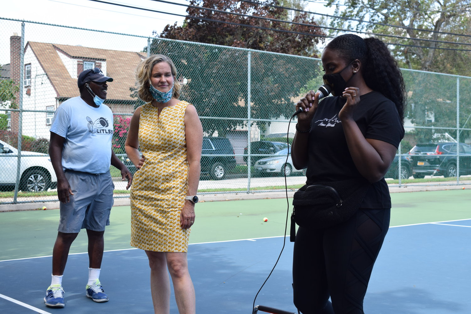 State Assemblywoman Taylor Darling, right, and Nassau County Executive Laura Curran shared their experiences learning tennis from Daniel Burgess.