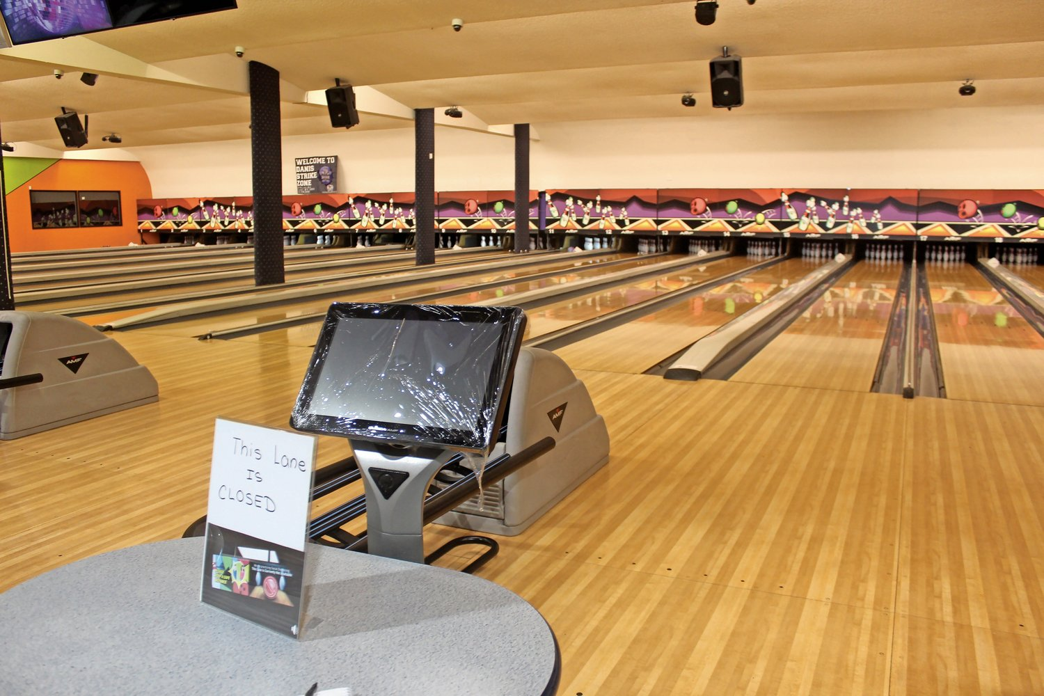 Every lane console is encased in plastic wrap, and bowlers can only use every other lane.