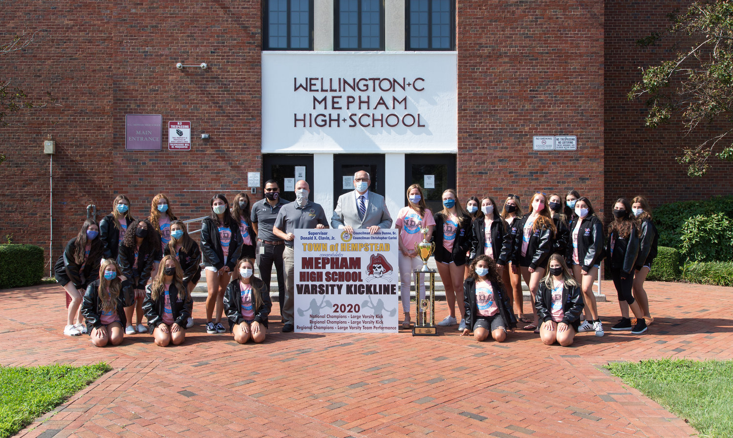 The Town of Hempstead presented Mepham High School's varsity kickline team with a national championship sign on Aug. 17.