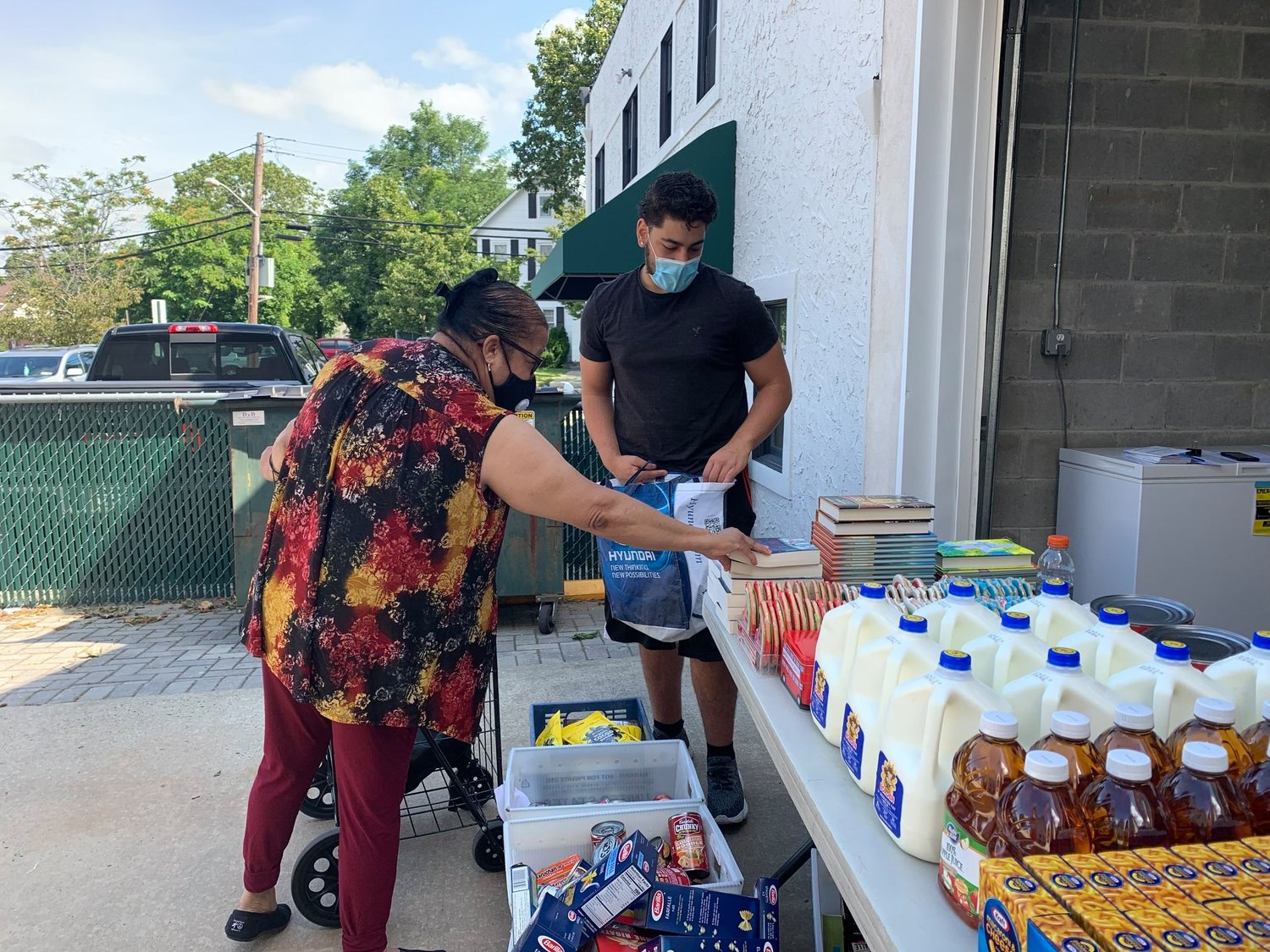 Volunteer Justin Ciofiallo, right, provided assistance at a recent food drive.