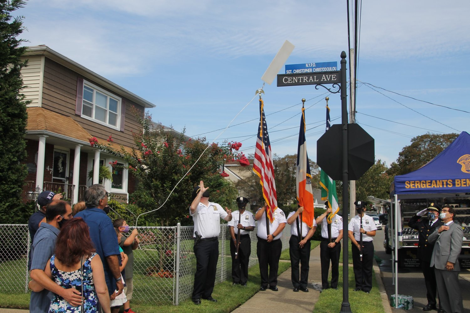 The Christodoulou family gathered to watch officers unveil a new honorary street sign at Central and Hodson avenues honoring the late NYPD Sgt. Christopher Christodoulou.
