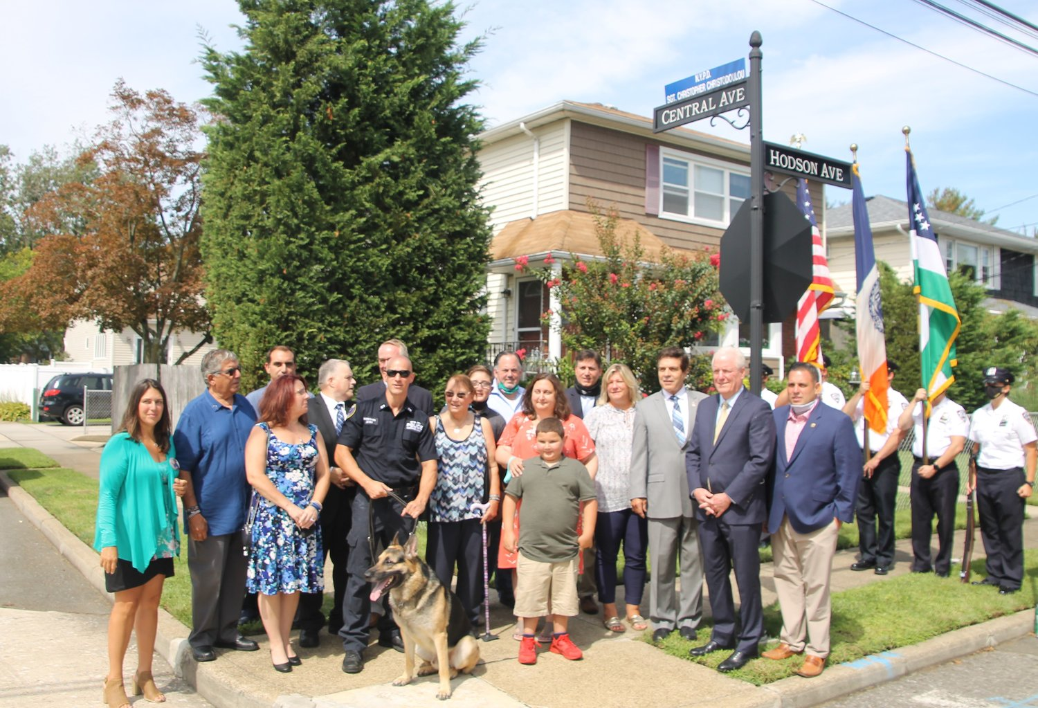 Family, friends and uniformed police officers gathered at the corner of Hodson and Central avenues as a new street sign honoring Christodoulou was unveiled.