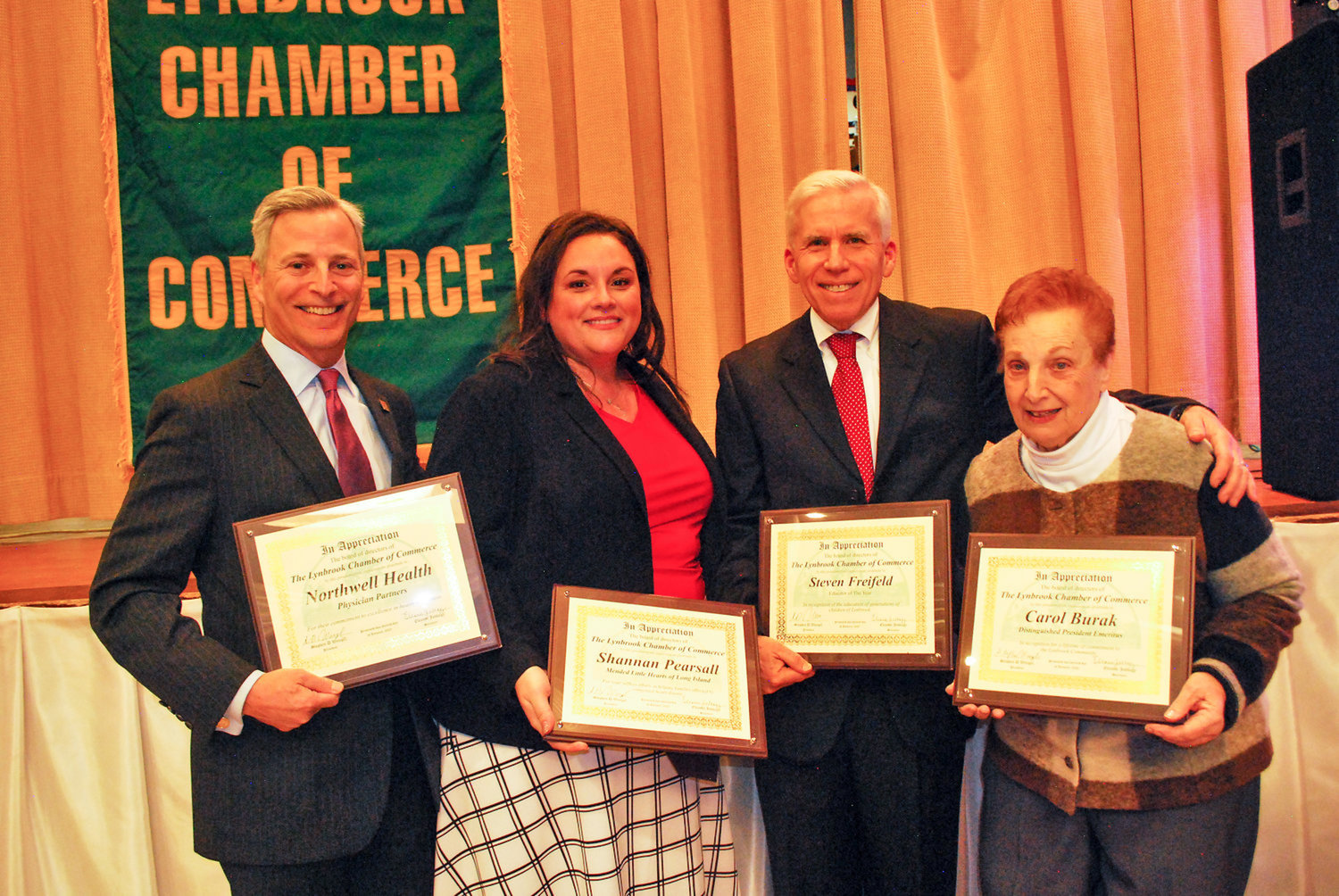 The Lynbrook Chamber of Commerce hosted its annual Evening of Excellence dinner on Jan. 30, at which it honored community leaders and installed officers. Honorees included, from left, Ira Nash, of Northwell Health Physician Partners; Shannan Pearsall, of Mended Little Hearts of Long Island; Steve Freifeld, a Marion Street School teacher; and Carol Burak, a former chamber president.