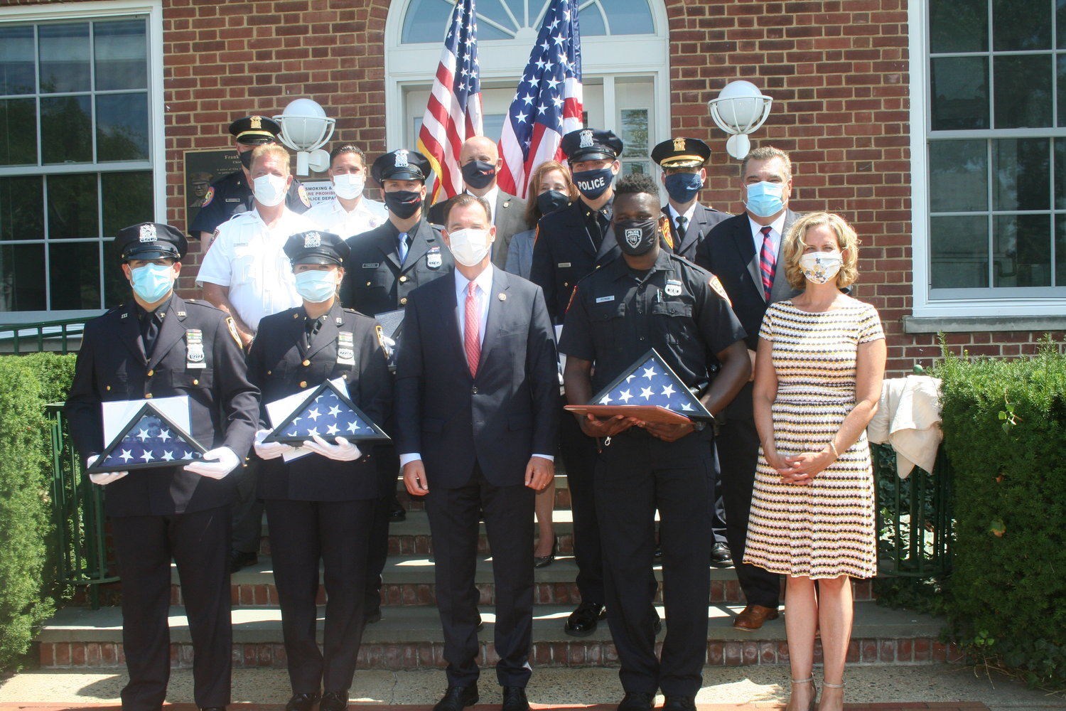 Suozzi, center front, said the five officers being honored were shining examples of good police work.