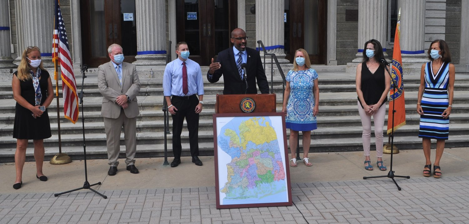 Minority Leader Kevan Abrahams, center, was joined during his press conference to support a change in the redistricting process by from far left, Legislators Delia DeRiggi-Whitton, Arnold W. Drucker, Joshua Lafazan and Debra Mulé, and Lisa Tyson and Legislator Ellen W. Birnbaum.