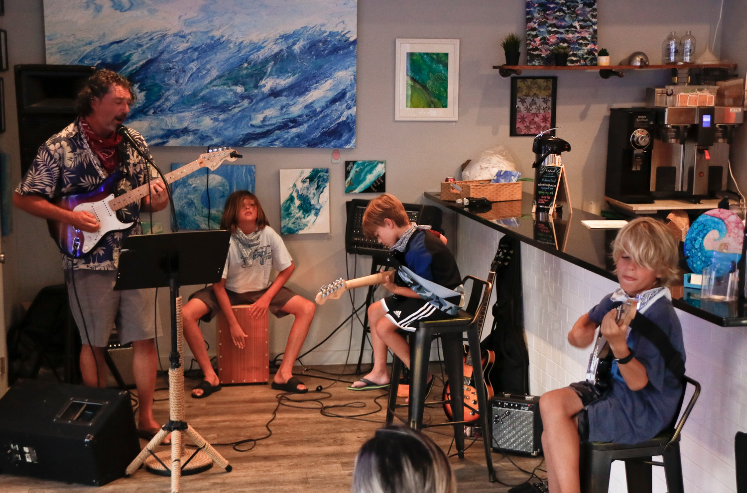 Studio owner Ben Noir played a variety of songs with, from left, Lars Sorensen, 13, on the Cajon, Paul Vivot, 8, on guitar and Finn Long, 11 also on guitar.