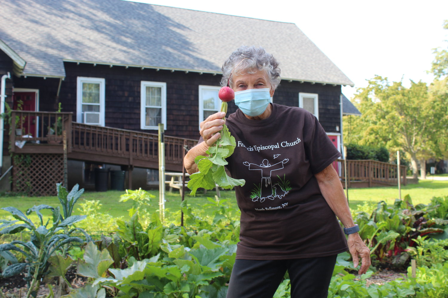 Camille Gaynor showed off a deep pink radish pulled fresh from the garden at St. Francis Episcopal Church in North Bellmore.