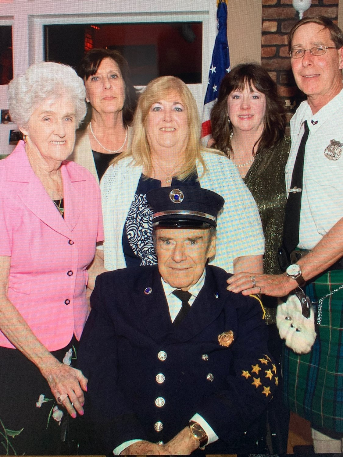 Abrams's family — from left, Agnes, Theresa, Tina, Tami and Martin Jr. — joined him at the Merrick Fire Department's 2017 installation dinner, at which he received a plaque commemorating 50 years in the fire service.