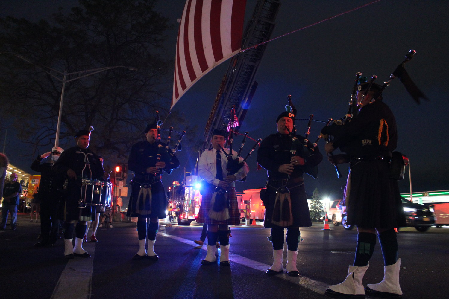 The rousing sound of bagpipes — played by members of NYPD's Pipe Band — sounded across the ceremony.
