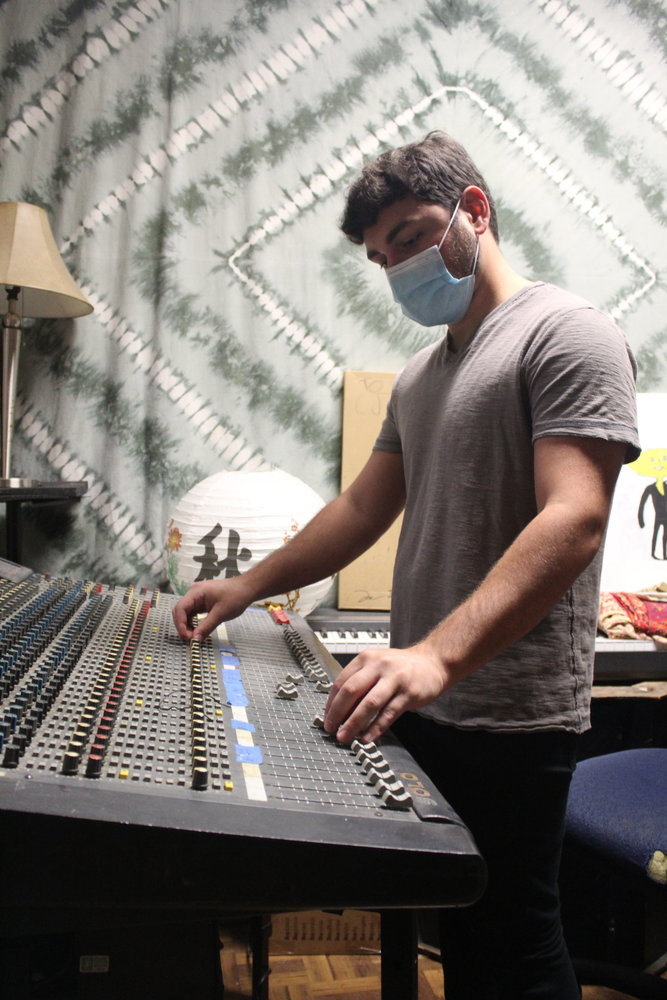 Nick Marano, 20, of Melville, adjusted a sound mixing board in one of the Rock Underground's studios. He teaches guitar and piano at the music school.