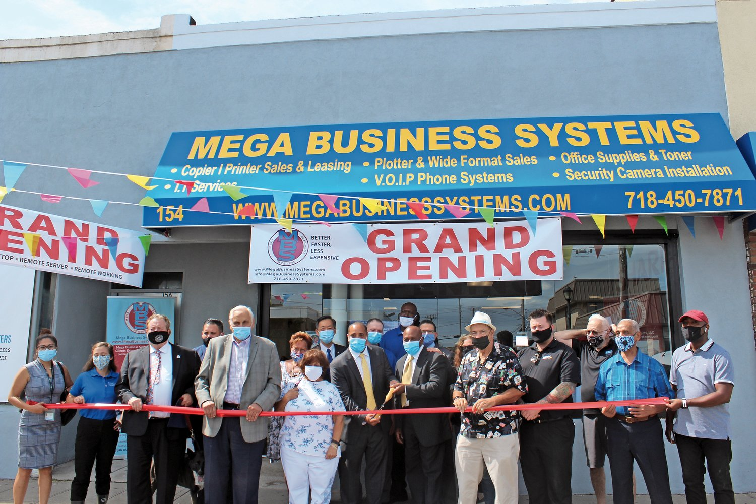 Members of the Island Park Chamber of Commerce, as well as local elected officials, joined Mega Business Systems for its grand opening on Long Beach Road in Island Park.