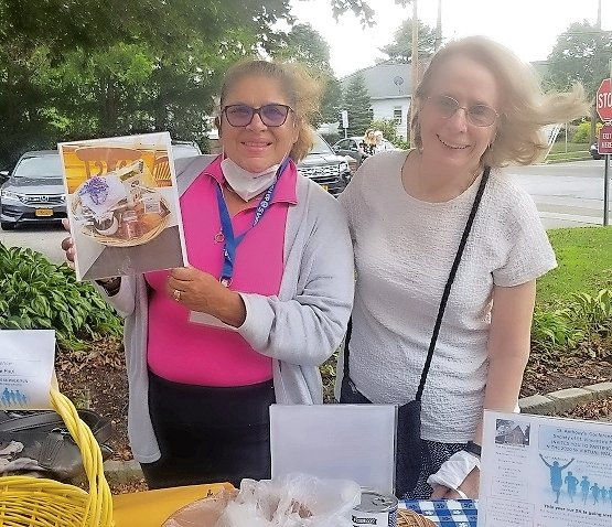Janet Calderon, left, and Missy Androu, co-chairs of the 5K and walk committee, recently helped raise funds and register participants outside St. Anthony's Church in Oceanside.