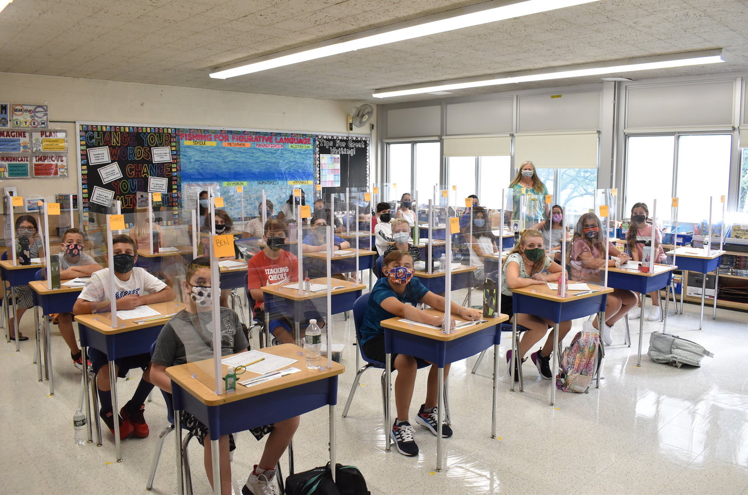 MaryAnn Gilroy's sixth graders were glad to be back, even with masks and desk barriers.