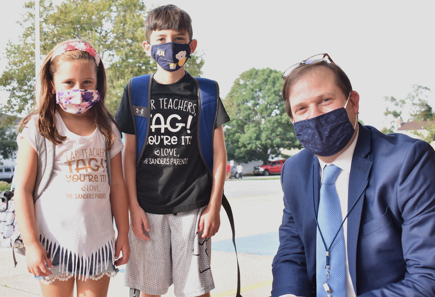 Principal Jeff Rosof greeted the Sander siblings, second grader Skylar and fifth grader Jordan.