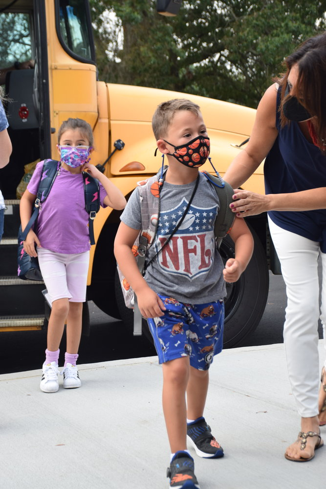 Students greeted the new school year with confidence as they made their way from the bus.