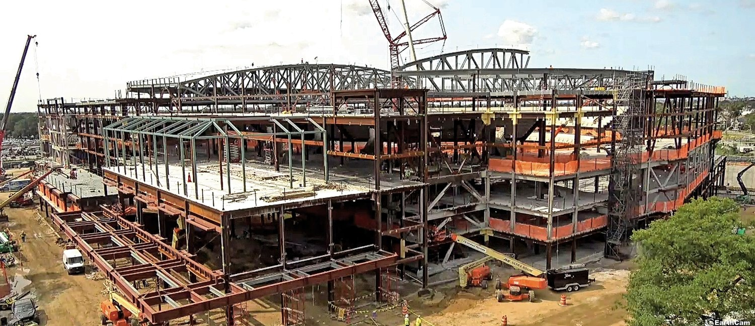 Construction crews are working on the roof, and have already installed the beams of the new UBS Arena.