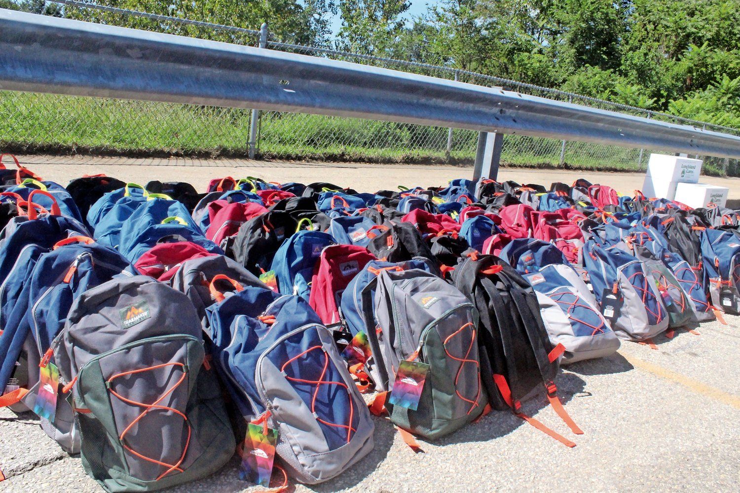 The backpacks contained a variety of school supplies, and were organized by grade level.