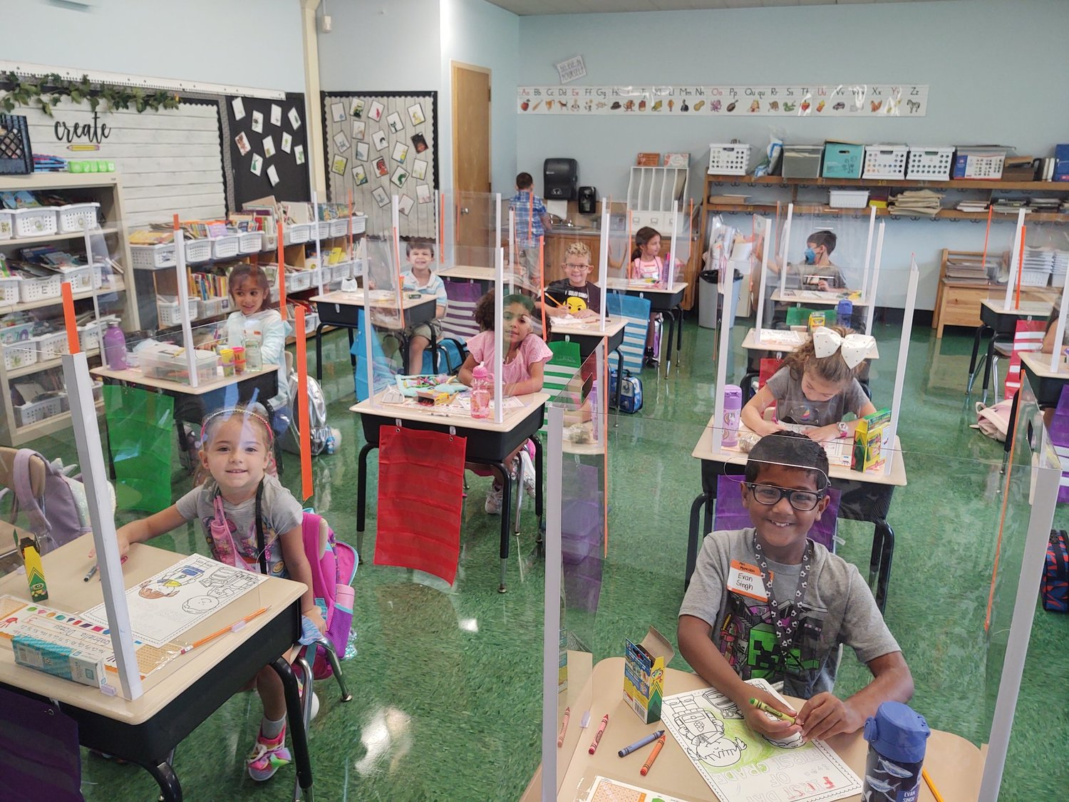 First grade students from Parkway Elementary School in the East Meadow School District sat at desks affixed with desk guards on their first day of classes on Sept. 8.
